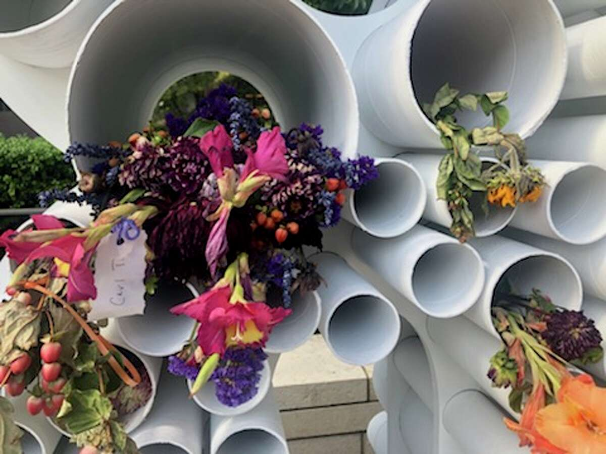 White tubes assembled to create the numbers '508' stand about 8 feet tall outside Seattle City Hall to commemorate the over 500 overdose deaths in the city since September 2016. Some are filled with bouquets or a small tag in memory of those who have died.