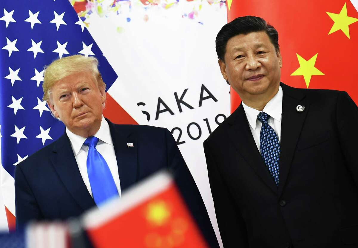 (FILES) In this file photo taken on June 29, 2019 Chinese President Xi Jinping (R) and US President Donald Trump attend their bilateral meeting on the sidelines of the G20 Summit in Osaka, Japan. - US President Donald Trump on August 30, 2019, denied his trade wars were harming the US economy, instead blaming the Federal Reserve for allowing a strong dollar that makes US exports less competitive.