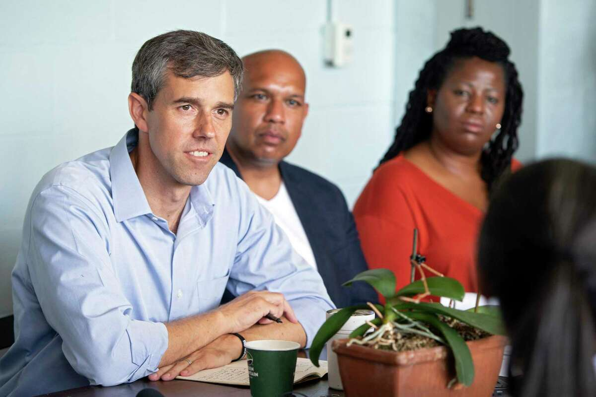 Beto O'Rourke, next to Nick Rathod and Yolunda Harrell, listens to community members during a campaign stop in Charlottesville, Va., Aug. 31.