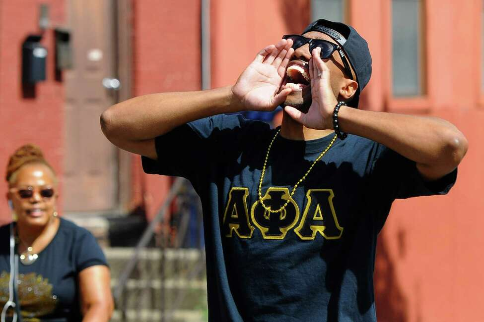 Bryan Jones, a member of the Alpha Phi Alpha African American fraternity, chants as he and others walk in the Capital Region's first African Heritage Parade in Albany, N.Y. on Saturday, Aug. 31, 2019. (Jenn March, Special to the Times Union )