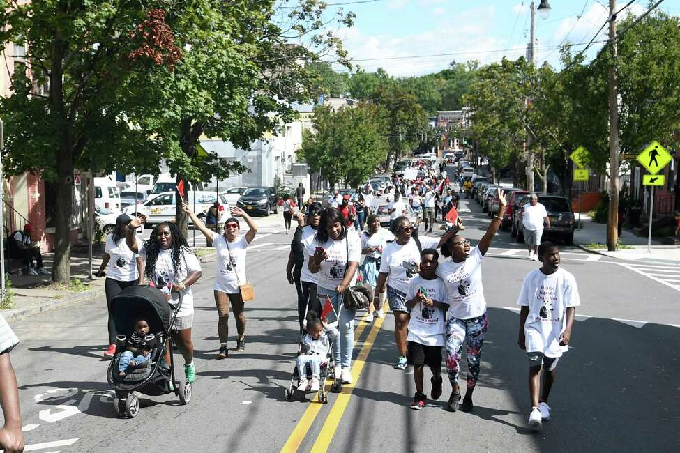 Various groups are seen marching up Lark Street in the Capital Region's first African Heritage Parade in Albany, N.Y. on Saturday, Aug. 31, 2019. (Jenn March, Special to the Times Union )