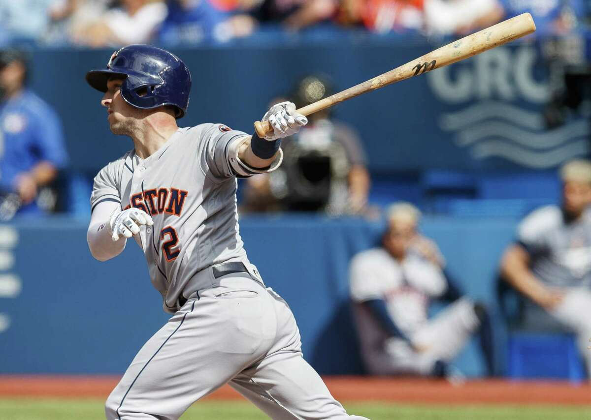 TORONTO, ONTARIO - AUGUST 31: Alex Bregman #2 of the Houston Astros hits an RBI sacrifice fly against the Toronto Blue Jays in the first inning during their MLB game at the Rogers Centre on August 31, 2019 in Toronto, Canada.