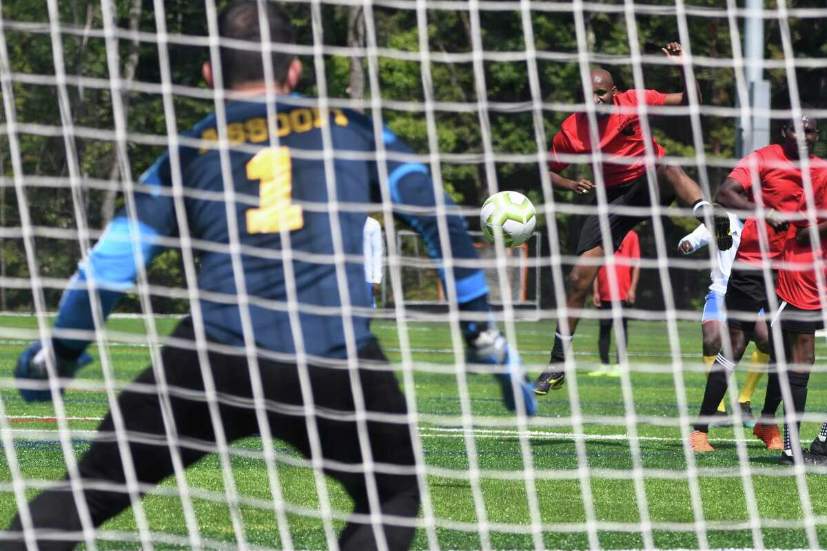 Michigan Team goalkeeper Lazaar Assofi prepares to save the ball as it flies over his defenders during their game against Arizona at the Sudanese Soccer Tournament in Afrim's Sports Park in Colonie, N.Y. on Saturday, Aug. 31, 2019. (Jenn March, Special to the Times Union )