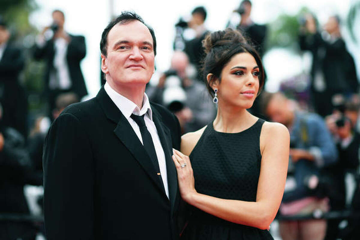 """Film director Quentin Tarantino and his wife Daniela Pick pose for photographers in May upon arrival at the premiere of the film """"The Wild Goose Lake"""" at the 72nd International Film Festival, Cannes, Southern France. Tarantino is about to become a father. His representative Katherine Rowe says the """"Once Upon a Time... In Hollywood"""" director and Pick, an Israeli model and singer, are expecting a baby. The couple met in 2009 and married last November. It's the first child for Tarantino, 56, who also directed """"Pulp Fiction"""" and """"Reservoir Dogs,"""" and Pick, 35."""