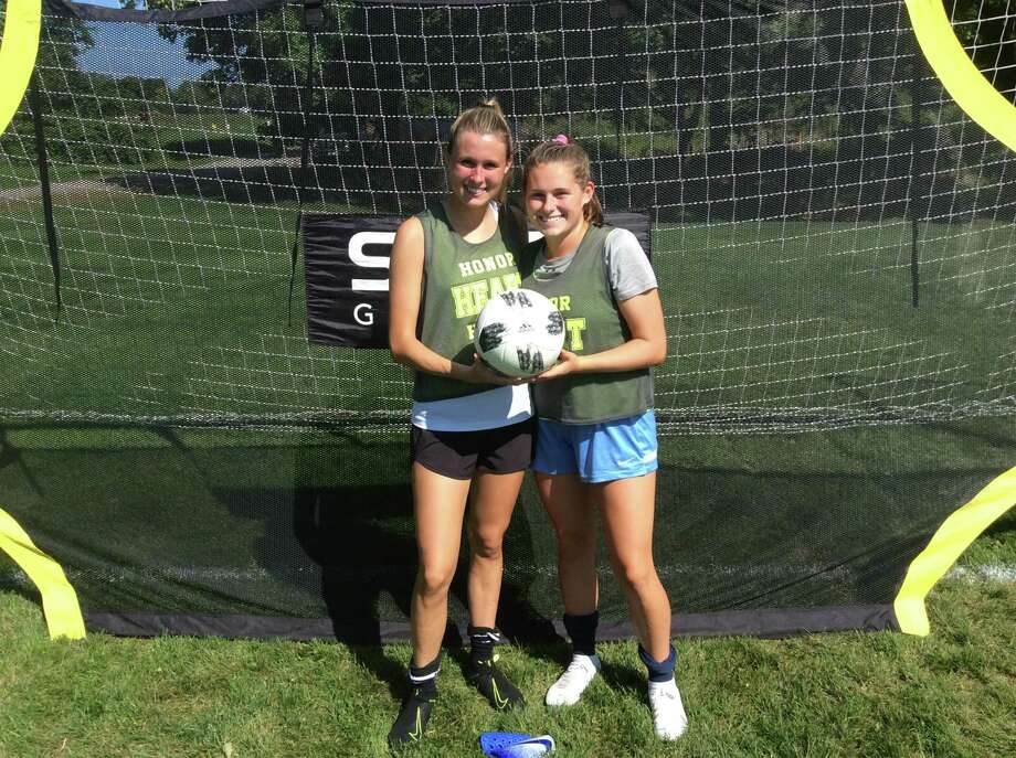 Taylor O'Meara, left and Amelia Sheehan, are senior captains on the Sacred Heart Greenwich soccer team. Photo: David Fierro / Hearst Connecticut Media