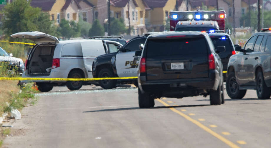 Odessa and Midland police and sheriff's deputies surround the area behind Cinergy in Odessa where one shooter who stole a mail truck 08/31/19 was detained and killed. Tim Fischer/Reporter-Telegram Photo: Tim Fischer/Midland Reporter-Telegram / Midland Reporter-Telegram