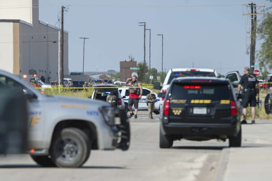 Odessa and Midland police and sheriff's deputies surround the area behind Cinergy in Odessa where one shooter who stole a mail truck 08/31/19 was detained and killed. Tim Fischer/Reporter-Telegram Photo: Tim Fischer/Midland Reporter-Telegram