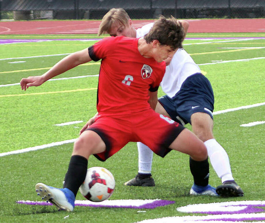 Alton's Lucas Kercher (6) battles for the ball with Rochester's Jacob Milnes Saturday during Kahok/Redbird Tournament action in Collinsville. Rochester won 7-2. Photo: Pete Hayes | The Telegraph