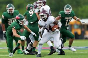 Cy-Fair running back L.J. Johnson (34) runs the ball during the second quarter of a non-district high school football game at Woodforest Bank Stadium, Saturday, Aug. 31, 2019, in Shenandoah.