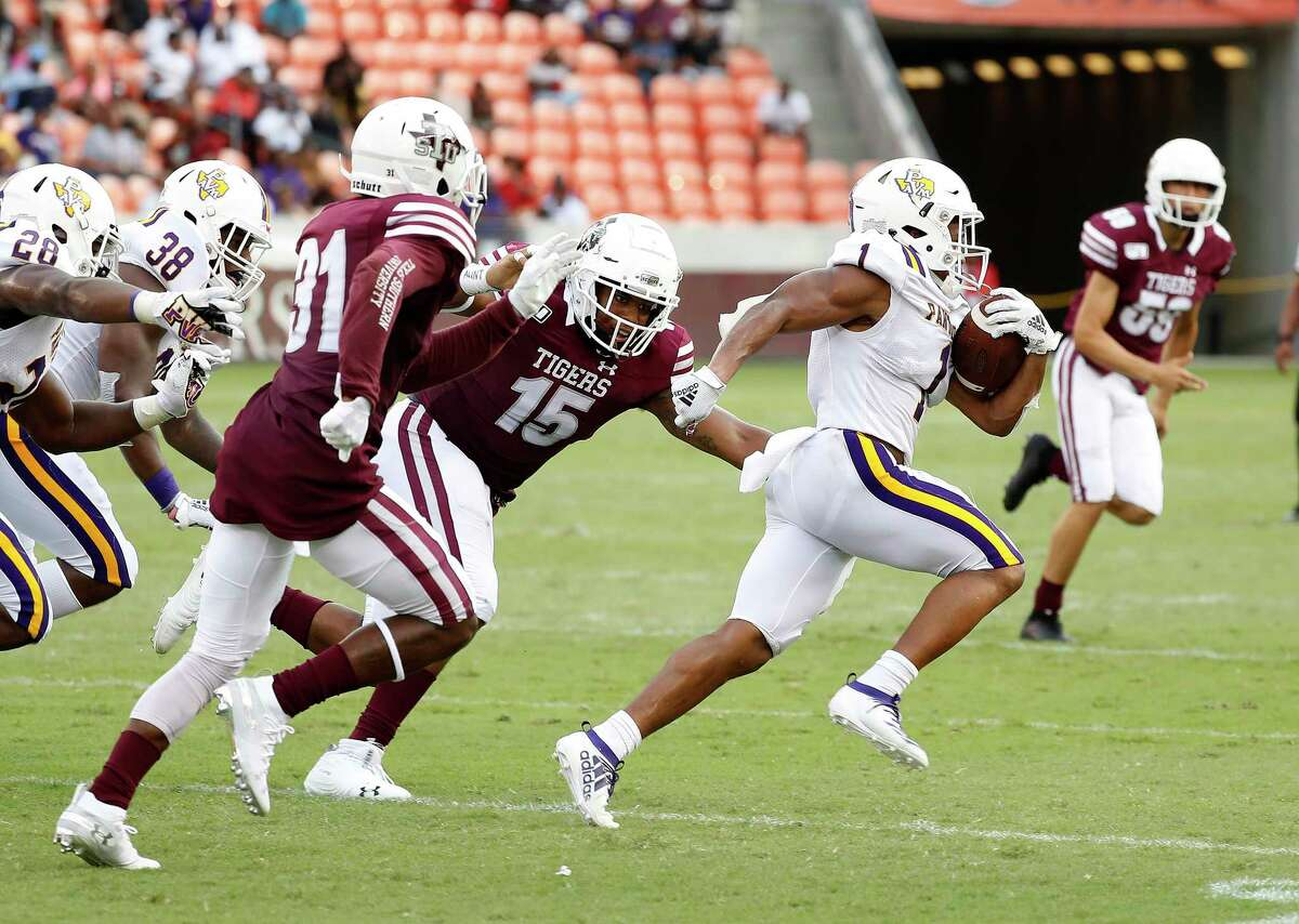 Prairie View A&M Panthers running back Dawonya Tucker (1) runs the ball as Texas Southern Tigers linebacker Tim Walton (15) and Byron Edwards (31) tried to tackle him in the first quarter of a college football game at BBVA Stadium, 8/31/19, in Houston.
