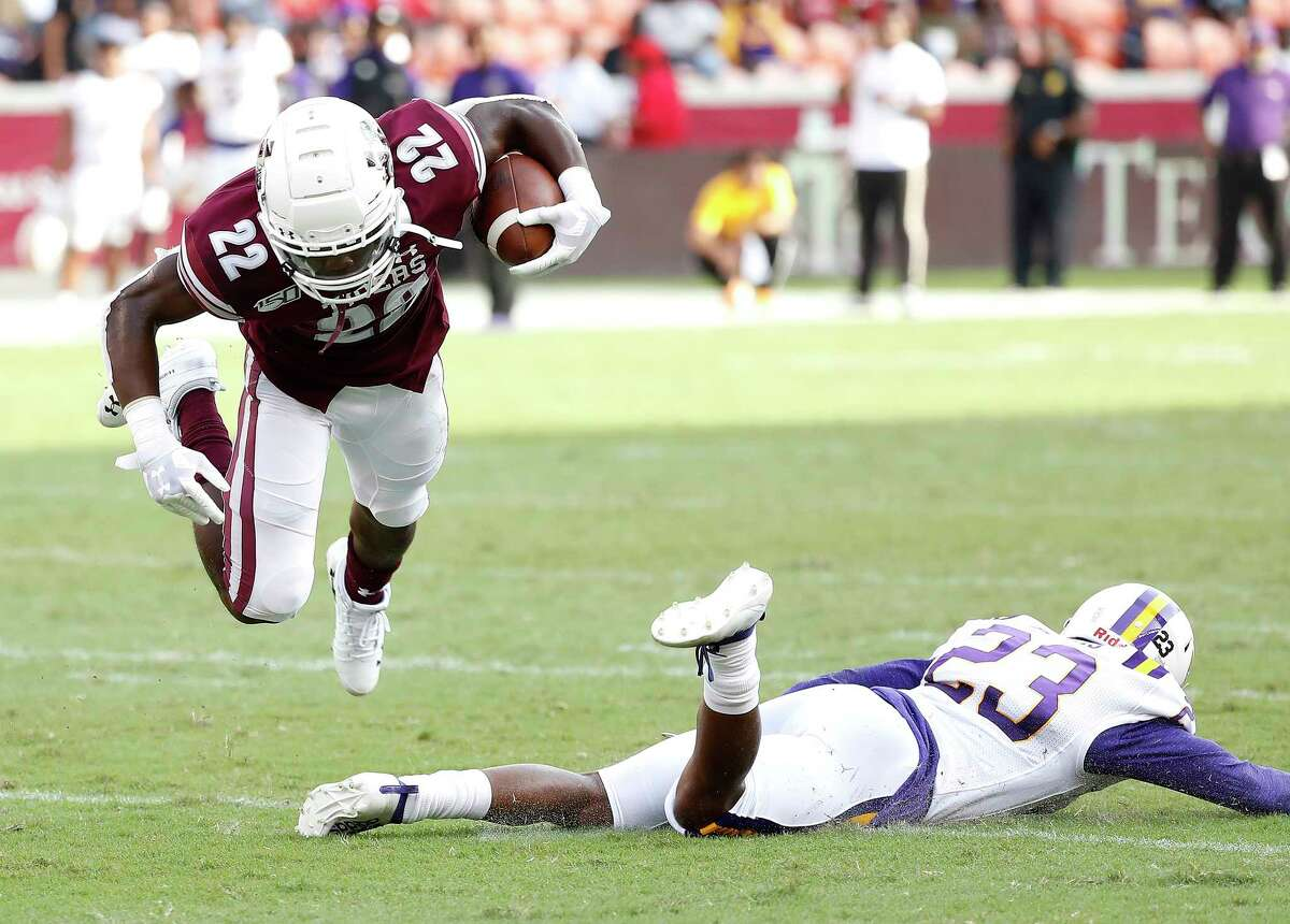 Texas Southern Tigers running back Ladarius Owens (22) leaps over Prairie View A&M Panthers cornerback Jaylen Harris (23) in the first quarter of a college football game at BBVA Stadium, 8/31/19, in Houston.