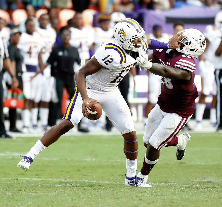 Prairie View A&M Panthers quarterback Jalen Morton (12) tries to shake off Texas Southern Tigers linebacker Patrick Howell (28) in the first quarter of a college football game at BBVA Stadium, 8/31/19, in Houston. Photo: Karen Warren, Houston Chronicle / @Houston Chronicle 2019