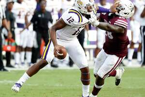 Prairie View A&M Panthers quarterback Jalen Morton (12) tries to shake off Texas Southern Tigers linebacker Patrick Howell (28) in the first quarter of a college football game at BBVA Stadium, 8/31/19, in Houston.