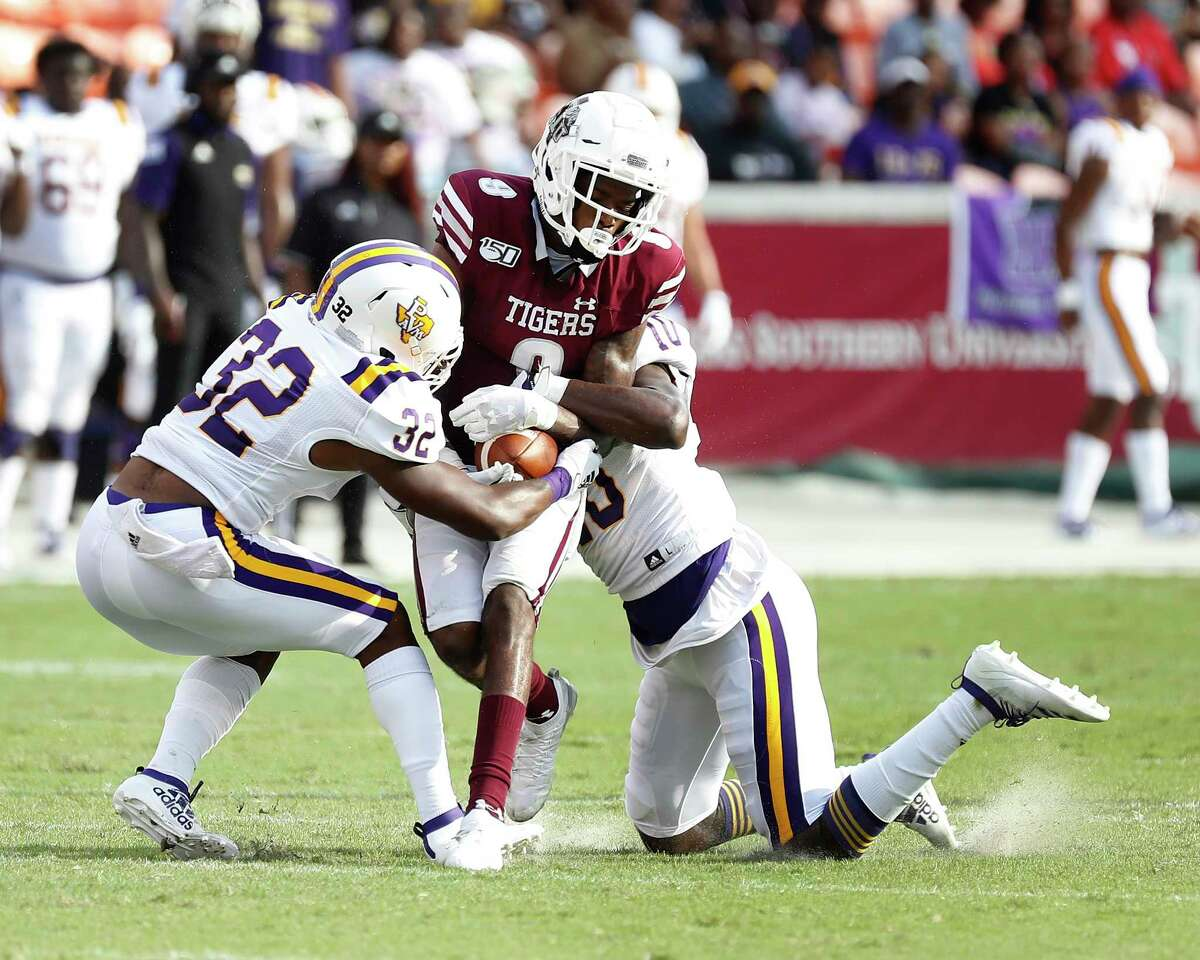 Texas Southern Tigers wide receiver Donnie Corley (9) gets tackled by Prairie View A&M Panthers defensive back Darius Hawkins (32) and DeMarcus Robinson (10) in the first quarter of a college football game at BBVA Stadium, 8/31/19, in Houston.