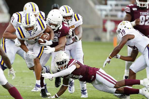 Prairie View A&M Panthers running back Dawonya Tucker (1) gains yardage against Texas Southern Tigers defensive back Kenterious Walker (24) in the second quarter of a college football game at BBVA Stadium, 8/31/19, in Houston.