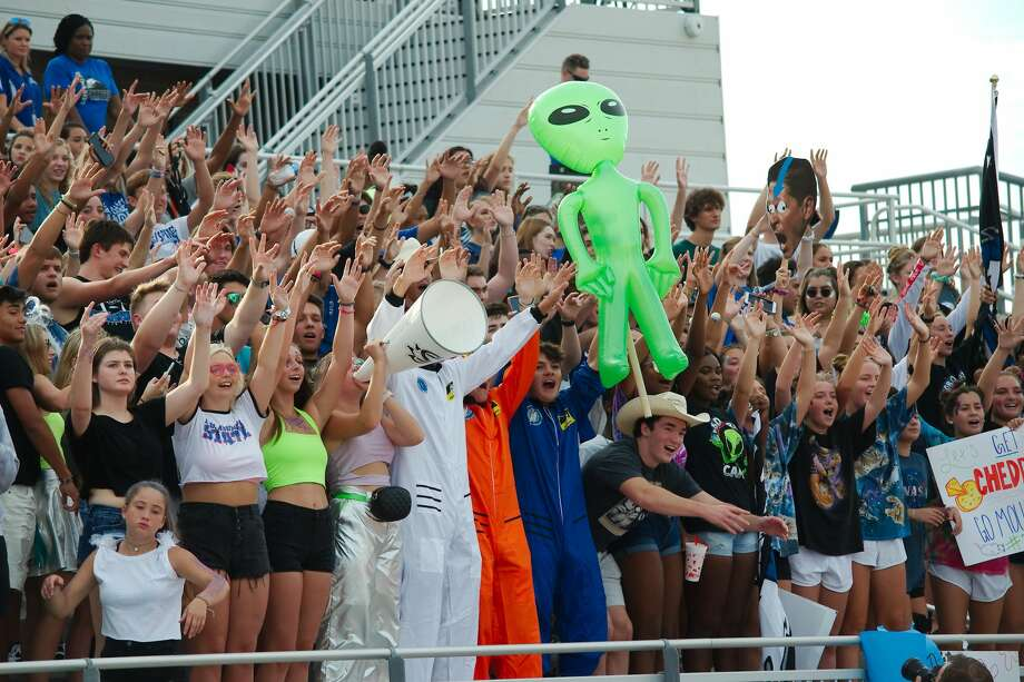 Out of this world Clear Springs fans cheer on the Chargers against Converse Judson Saturday, Aug. 31 at CCISD Challenger Columbia Stadium. Photo: Kirk Sides/Staff Photographer
