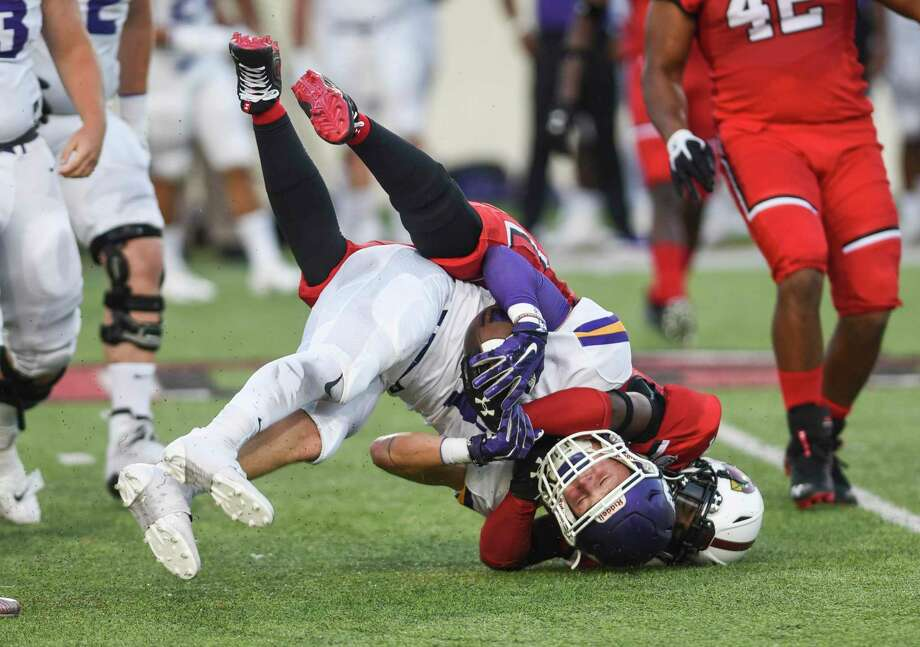 A Lamar player brings down a Bethel player during the first half at Lamar's season opener against Bethel University Thursday in Provost Umphrey Stadium. Photo taken on Thursday, 08/29/19. Ryan Welch/The Enterprise Photo: Ryan Welch, Beaumont Enterprise / The Enterprise / © 2019 Beaumont Enterprise