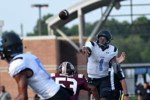 ShadowCreek junior quarterback Kyron Drones (1) drops a pass over the head of Summer Creek senior outside linebacker Deveon Wright (53) intended for Sharks senior wide receiver Seth Jones, left, during the first quarter of their non-district season opener at Turner Stadium in Humble on August31, 2019.