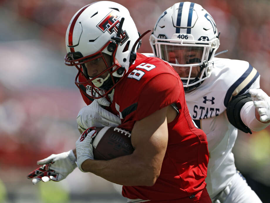 Texas Tech's Dalton Rigdon (86) runs with the ball as he is tackled by Montana State's Sal Aguilar (46) during the first half of an NCAA college football game, Saturday, Aug. 31, 2019, in Lubbock. (Brad Tollefson/Lubbock Avalanche-Journal via AP) Photo: Brad Tollefson/Lubbock Avalanche-Journal Via AP