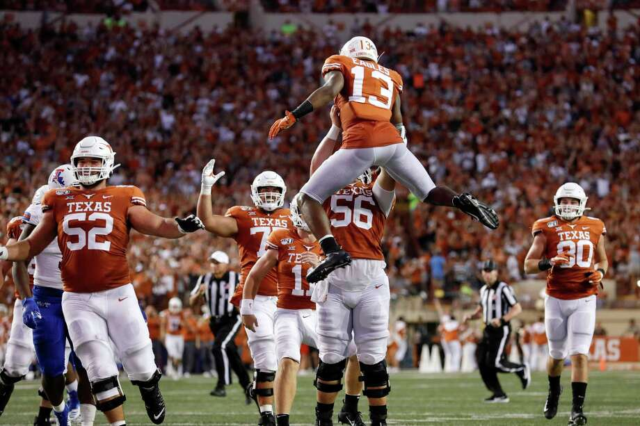AUSTIN, TX - AUGUST 31:  Zach Shackelford #56 of the Texas Longhorns lifts Brennan Eagles #13 after a touchdown reception in the second quarter against the Louisiana Tech Bulldogs at Darrell K Royal-Texas Memorial Stadium on August 31, 2019 in Austin, Texas. Photo: Tim Warner, Getty Images / 2019 Getty Images