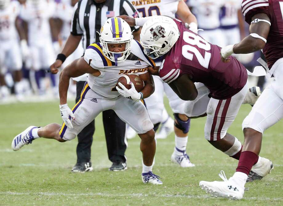 Texas Southern linebacker Patrick Howell, right, grabs a handful of Dawonya Tucker's jersey in an attempt to bring down the Prairie View running back Saturday at BBVA Stadium. Photo: Karen Warren, Staff Photographer / Houston Chronicle / @Houston Chronicle 2019