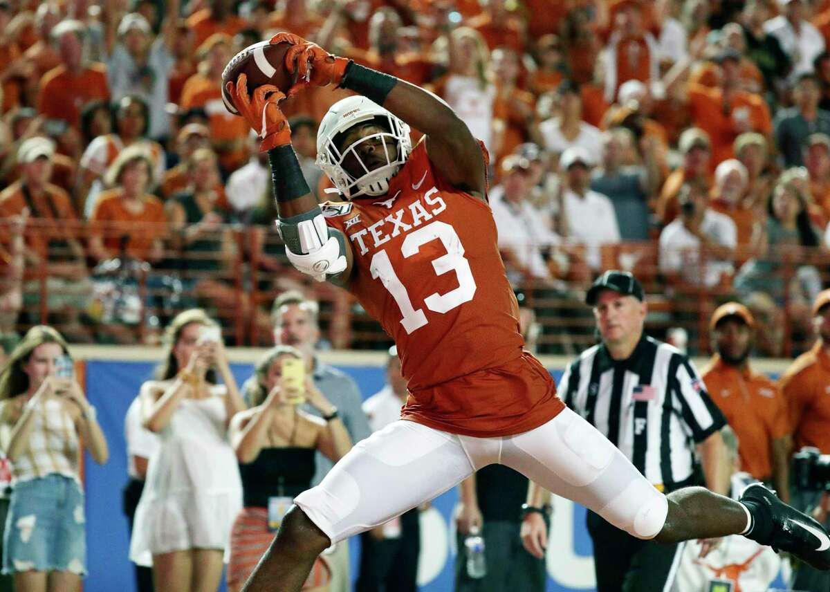 Texas wide receiver Brennan Eagles pulls in a pass for a touchdown against Louisiana Tech in the second half Saturday night.