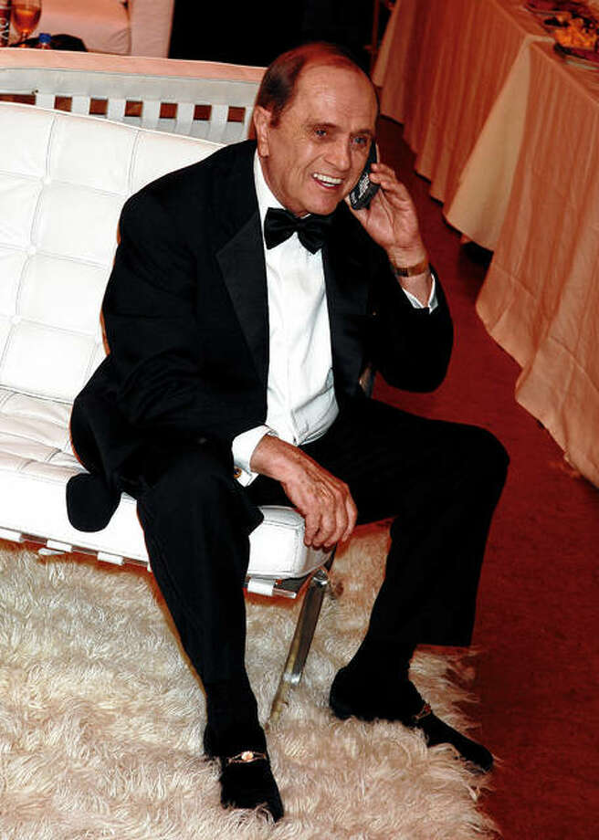 Bob Newhart talks on the phone in the green room during the 58th annual Primetime Emmy Awards in August 2006. Newhart, who got his career started by writing humorous routines based on telephone conversations, is turning 90 later this week. Photo: Jeff Kravitz | FilmMagic | Getty Images