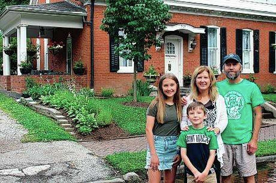 The McCullough family, Adrianna (from left), Shawn, Christina and Chad, bought an 1874 brick home in the Old Belleville Historic District four years ago. Photo: Teri Maddox | Belleville News-Democrat (AP)