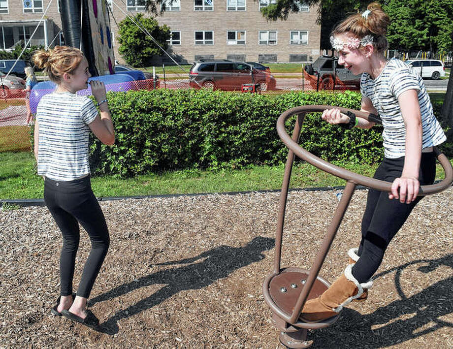 Kaya Brant (left) spins Lexi Laumakis during Our Saviour Parish's 2019 Family Fun Festival on Saturday. Photo: Marco Cartolano | Journal-Courier