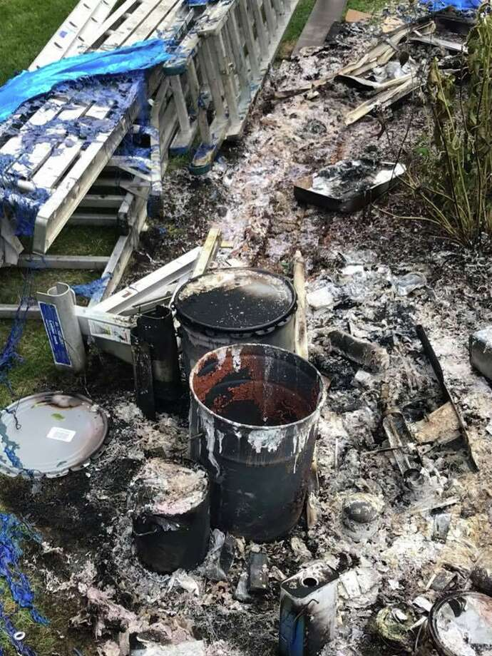 Monroe firefighters believe painter's equipment naturally combusted and caused a flash fire that burned materials and shrubbery. Firefighters investigated on Aug. 31, 2019. Photo: Contributed Photo / Contributed / The News-Times Contributed