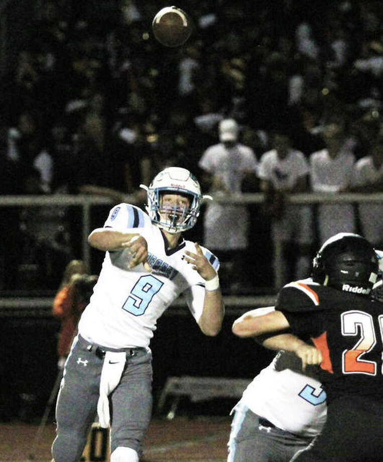 Jersey quarterback Matthew Jackson (left), shown throwing a pass in a game last season at Waterloo, ran for 170 yards and two touchdowns Saturday night in the Warriors' season-opening victory at Granite City. Photo: Greg Shashack / The Telegraph