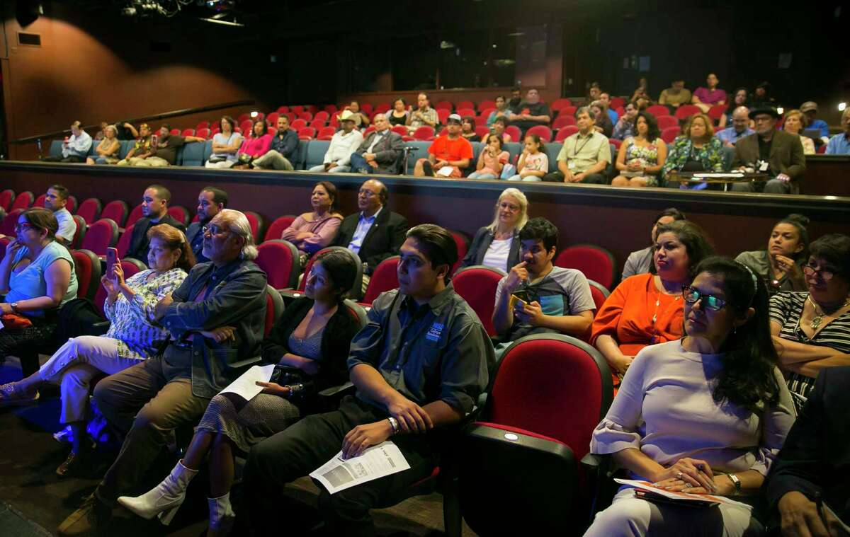 Audience members listen during a meeting at Talento Bilingue de Houston on Aug. 21.
