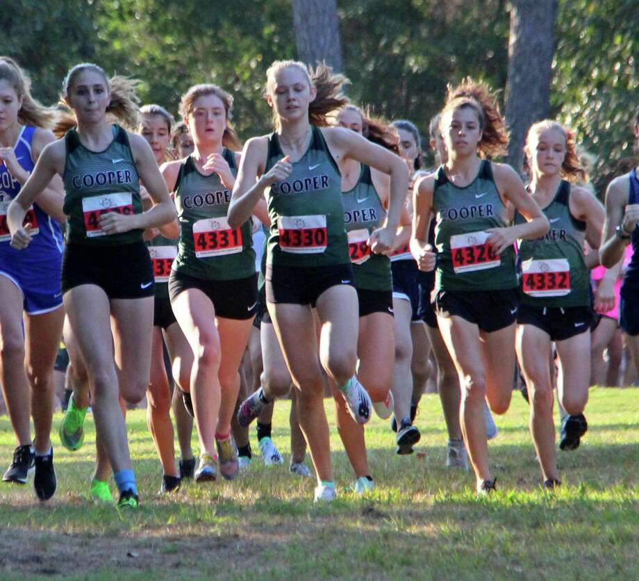 The John Cooper girls cross country team won their home invitational on Saturday morning at Burroughs Park in Tomball. Photo: Lynn Boeding / Cooper Athletics