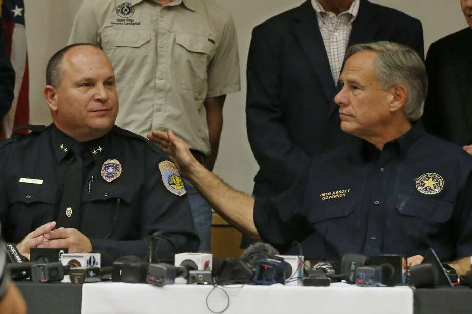 Texas Governor Greg Abbott, right, pats Odessa Police Chief Michael Gerke, left, on the shoulder during a news conference about Saturday's shooting, Sunday, Sept. 1, 2019, in Odessa, Texas. (AP Photo/Sue Ogrocki) Photo: Sue Ogrocki/Associated Press