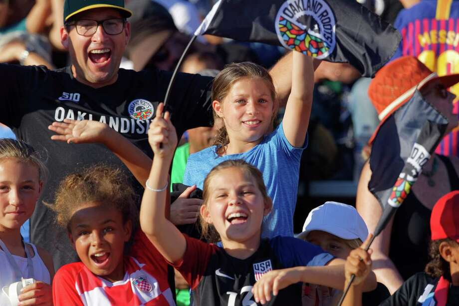 Fans cheer at the Oakland Roots first game on August 31, 2019 in Oakland. The Oakland Roots soccer team pledged that one percent of the team's salaries and ticket sales will be donated to social causes. Photo: Robert Edwards, Robert Edwards-KLC Fotos / Robert Edwards
