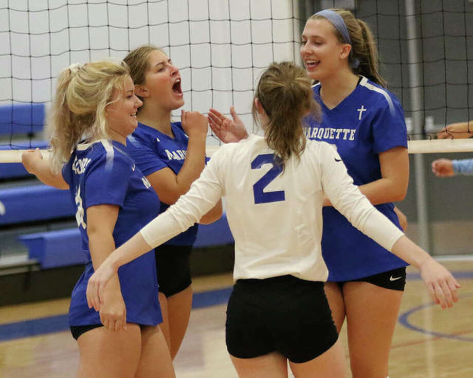 Marquette's (from left) Josey Wahl, Kristine Lauritzen, Delaney Cain (2) and Natalie Ellebracht celebrate a point in a pool play match against Jersey last week at the Roxana Tourney. The Explorers split a pair of matches Saturday to finish sixth in the tourney. Photo: Greg Shashack / The Telegraph