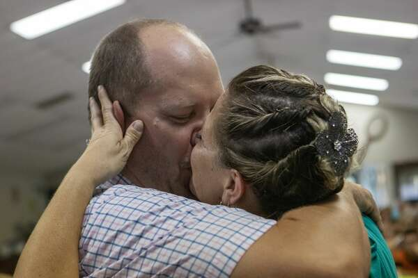 William and Kristie Gray kiss for the first time as a married couple during a vow renewal/wedding ceremony Saturday, August 31, 2019 at Lake Conroe RV and Camping Resort in Willis.