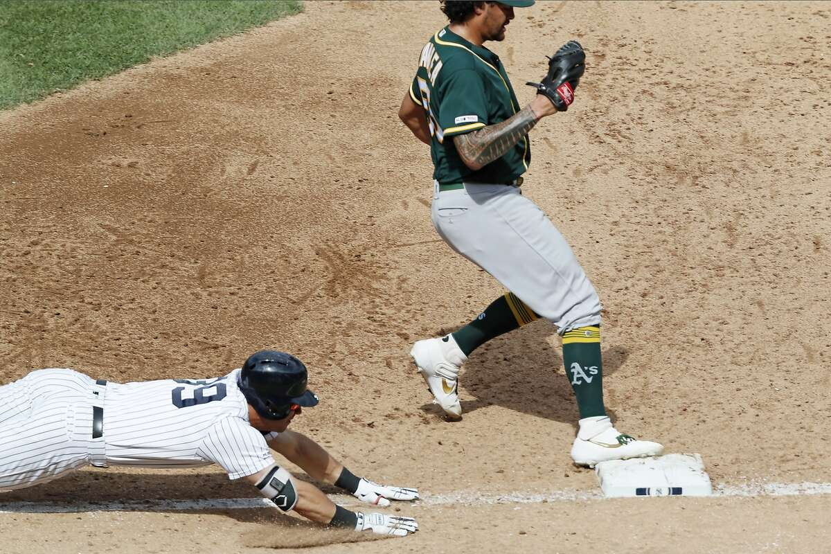 Oakland Athletics starting pitcher Sean Manaea steps on first to make the out on New York Yankees' Mike Tauchman (39) during the sixth inning of a baseball game, Sunday, Sept. 1, 2019, in New York. Tauchman grounded out with bases loaded for the final out of the inning. (AP Photo/Kathy Willens)
