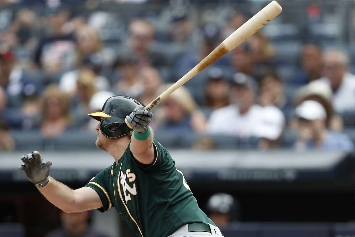 Oakland Athletics Sheldon Neuse watches his two-run double in the seventh inning of a baseball game against the New York Yankees, Sunday, Sept. 1, 2019, in New York. (AP Photo/Kathy Willens)