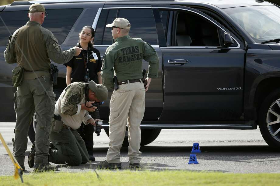 Investigators process a scene involved in the mass shooting in Odessa, Texas, Sept. 1, 2019. Records show that the accused gunman's parents reside in San Antonio. Photo: Sue Ogrocki/Associated Press