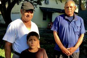 Fausto Canelas, left, from Honduras, with his grandson Emmanuel, 7, and Juan Mejia, from El Salvador. The two men live in Bridgeport under the Temporary Protected Status program and work as building cleaners in Norwalk with 32BJ SEIU.
