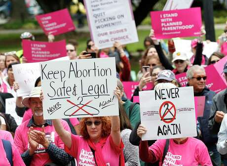 People gather May 21, 2019, at the state Capitol to rally in support of abortion rights in Sacramento, Calif.