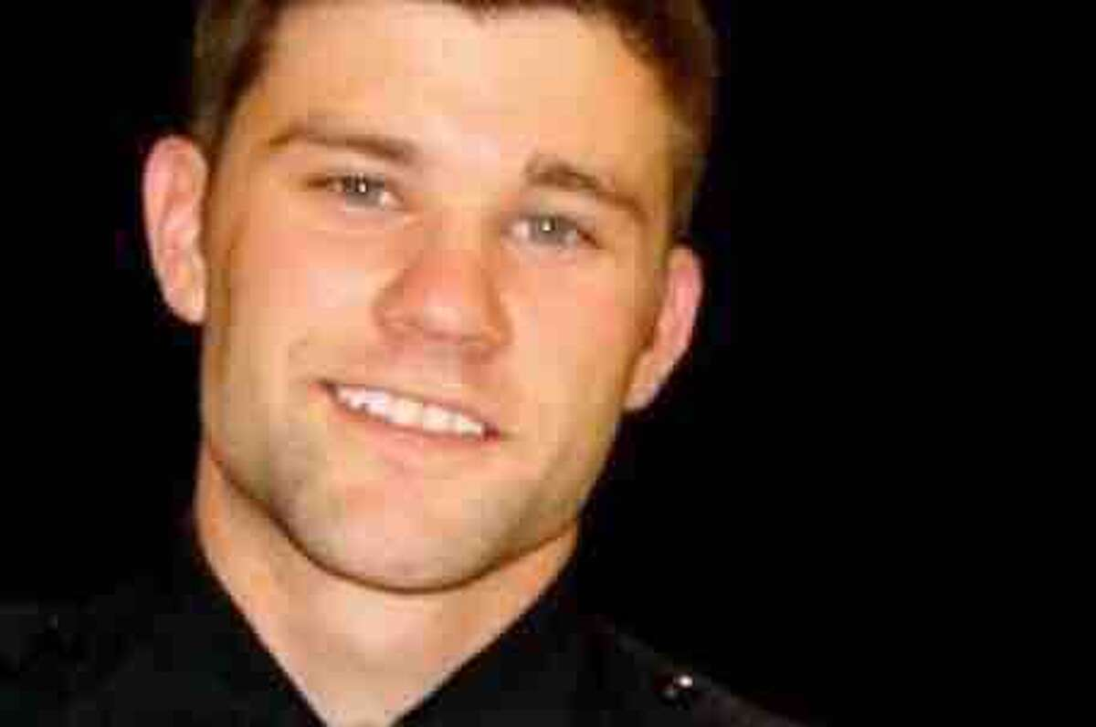 Midland Police Officer Zack Owenswas shot multiple times in the arm and hand, according to his mother who posted on the fundraiser. He has a fixator on his left index and middle finger; both knuckles were destroyed by the bullet entry. His right arm has a radial-head fracture and is in a sling.