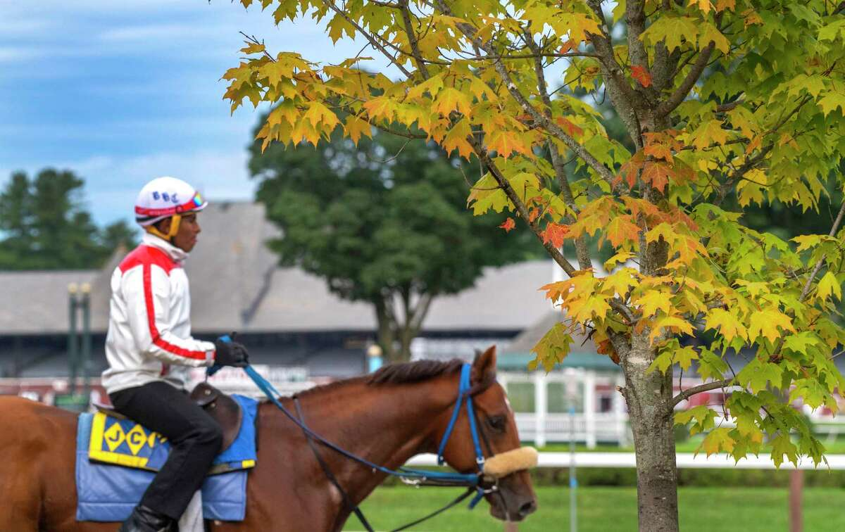 Exercise rider Aderlin Huacachi in a warm-up jacket sits atop Harris Bay trained by John Kimmel as the leaves start changing speaks of the end of the meeting at the Saratoga Race Course Sunday Sept. 1, 2019. The meeting ends Sept. 2nd in Saratoga Springs, N.Y. Photo Special to the Times Union by Skip Dickstein
