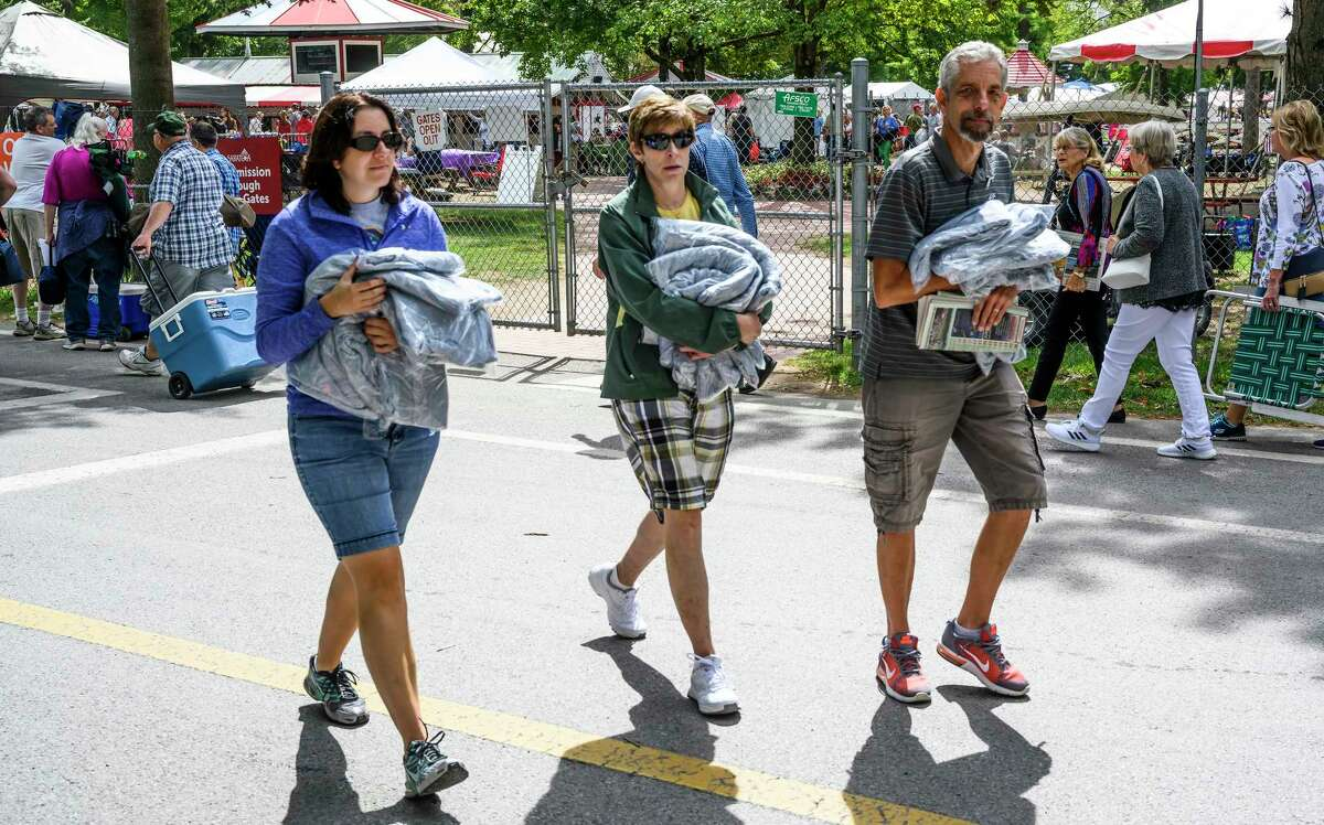 Happy patrons leave the track with armloads of sweatshirts on giveaway day at the Saratoga Race Course on sweatshirt giveaway day Sunday Sept. 1, 2019 in Saratoga Springs, N.Y. Photo Special to the Times Union by Skip Dickstein