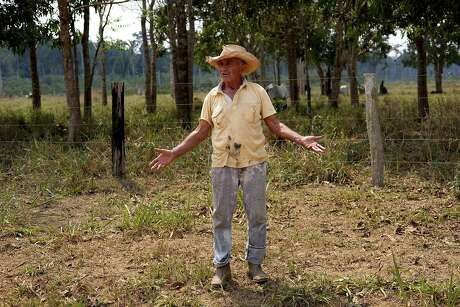 Antonio Lopes da Silva, a 75-year-old livestock farmer, poses for a photo at Vila Nova Samuel, in the Amazonian state of Rondonia, Brazil, Thursday, Aug. 29, 2019. Lopez Da Silva said the Amazon must be protected, but he also believes that that regulated fires to clear land for pasture are needed for the region and Brazil, to prosper amid a struggling economy. (AP Photo/Luis Andres Henao)