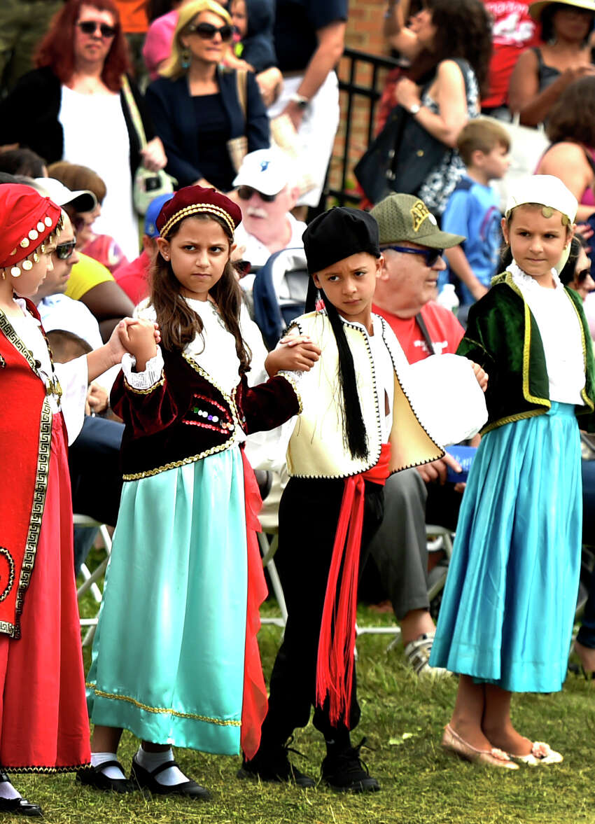 Orange, Connecticut - Sunday, September 1, 2019: Members of the Junior Odyssey Dancers, ages 7-10, perform during the St. Barbara Greek Orthodox Church 39th Annual Greek Festival Odyssey 2019 Sunday in Orange. The Labor Day weekend 4-day event of Hellenic traditions include all types of Greek culinary delights cooked on the festival grounds, Greek dancing and dance lessons, music, Greek cooking demonstrations, a gourmet Greek grocery, presentations on Greek Orthodoxy, a tag sale, children's activities rides, games and magic shows.