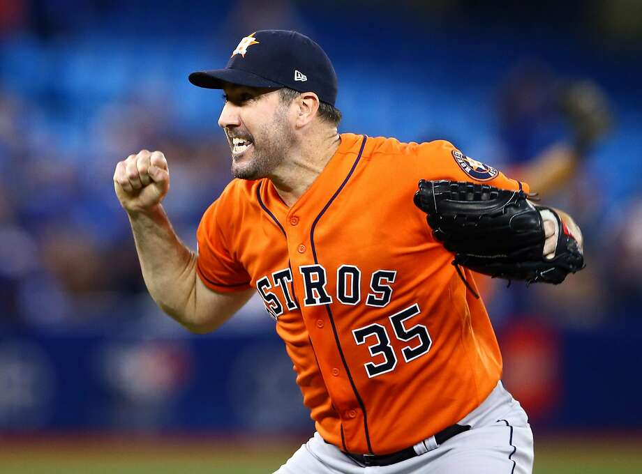 Houston's Justin Verlander prepares to celebrate after stymieing the Blue Jays in Toronto for his third career no-hitter. He retired the final 26 hitters. Photo: Vaughn Ridley / Getty Images