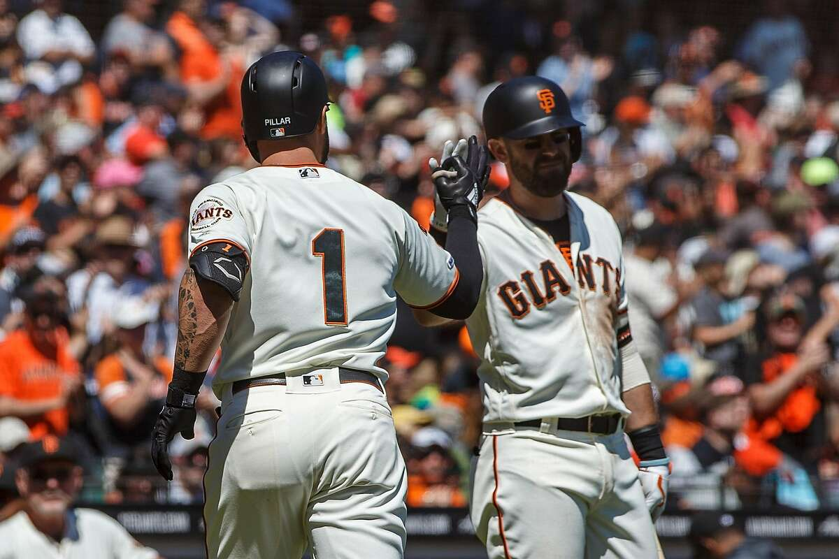 SAN FRANCISCO, CA - SEPTEMBER 01: Kevin Pillar #1 of the San Francisco Giants is congratulated by Evan Longoria #10 after hitting a two run home run against the San Diego Padres during the first inning at Oracle Park on September 1, 2019 in San Francisco, California. (Photo by Jason O. Watson/Getty Images)