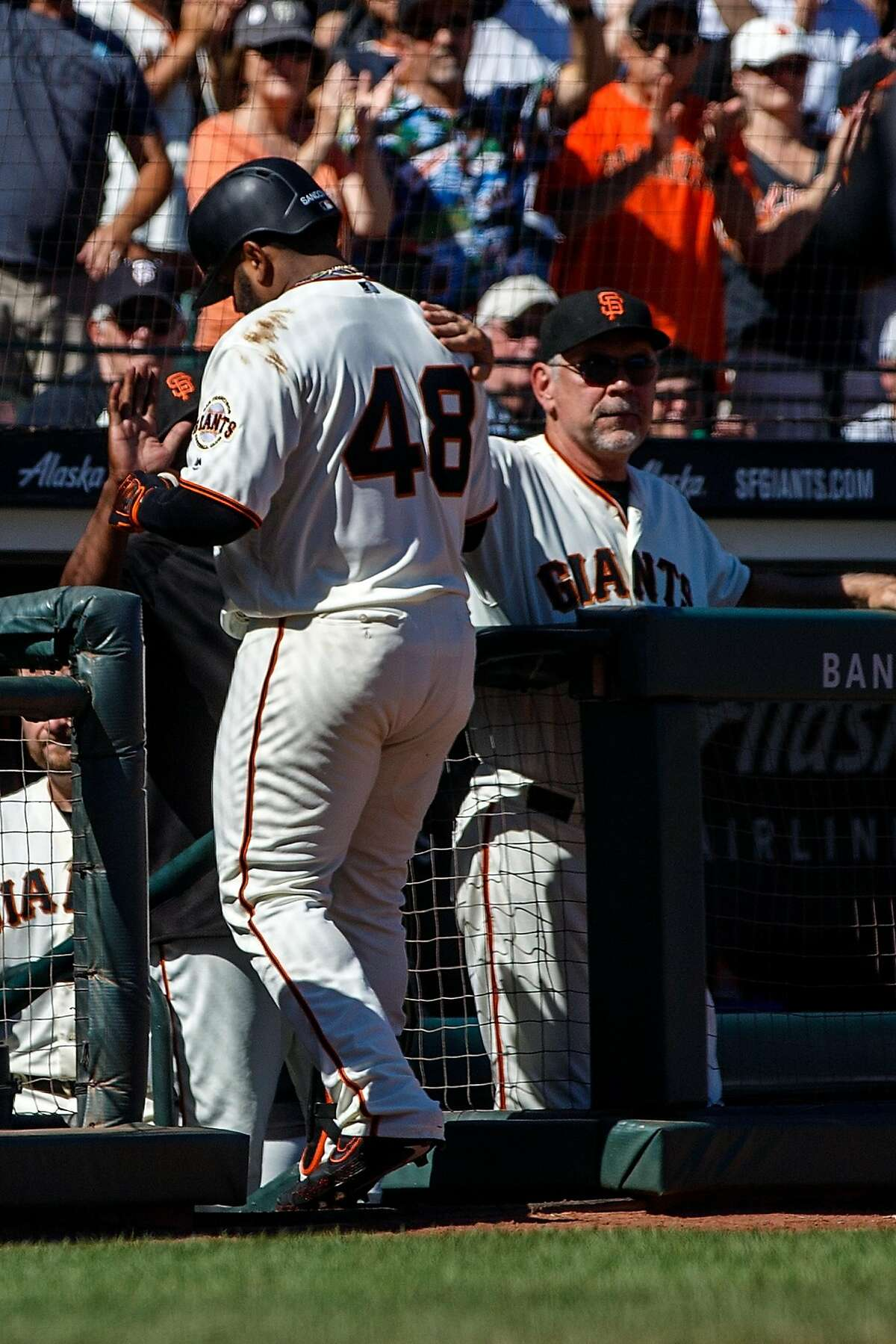 SAN FRANCISCO, CA - SEPTEMBER 01: Pablo Sandoval #48 of the San Francisco Giants is greeted by manager Bruce Bochy #15 in the dugout after grounding out against the San Diego Padres during the seventh inning at Oracle Park on September 1, 2019 in San Francisco, California. The San Diego Padres defeated the San Francisco Giants 8-4. (Photo by Jason O. Watson/Getty Images)
